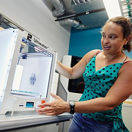 Student works with a 3D printer
