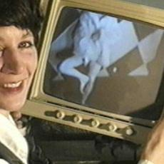 Woman holding tv monitor