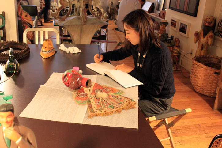 Student drawing at table